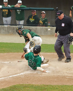 The ball skips past Taconic catcher Dylan Burke on a wild throw home during a decisive 4th inning for Austin Prep.