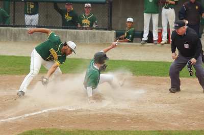 The throw home doesn't reach Taconic's Cedric Rose in time for him to prevent Austin Prep's Jonathan Gilbride from scoring in the fourth inning.