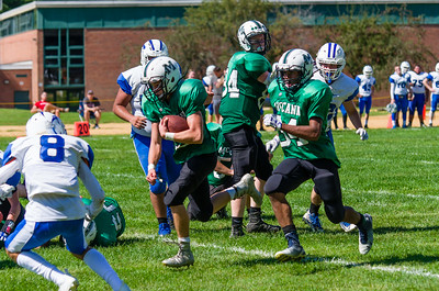 Josh Brazeau (23) rushes for a score in the second quarter.