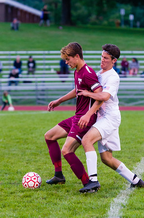 PHS midfielder Sam Higuera battles Monument Mountain's Noel Powell (9) for the ball during the first half..