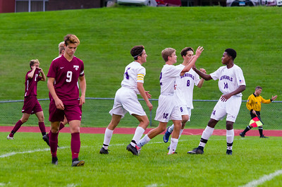 Luke Peplowski (12) celebrates a goal with his teammates.