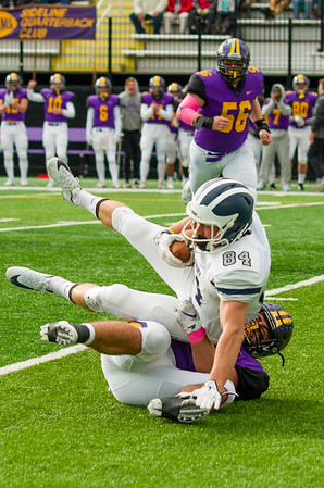 Ephs linebacker Desi O'Mahony tackles Middlebury's Maxwell Rye in the fourth quarter.