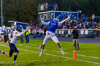 Tom Burris leaps high in the endzone, but this Tim Clayton pass just gets away from him.