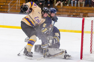 Nick VanBelle (16) battles with Michael Grande (5) near the Trinity net during the first period.