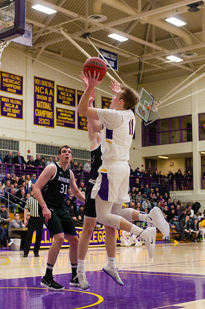 Williams' Bobby Casey (11) takes a shot early in the first half against Amherst.