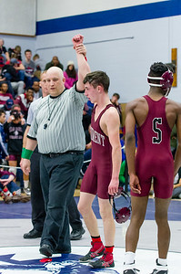 Monument Mountain wrestler Caleb Polland celebrates his win in the 113 lb weight class Saturday.