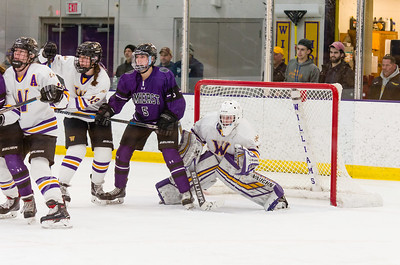 Ephs goalie Chloe Heiting fights to see around the screen of Amherst forward Angelina Wiater (5).