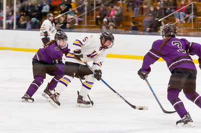 Ephs Michaela O'Connor (5) looks for an opening as Mammoths' Angelina Wiater (5) and Ava Simoncelli (3) close in.