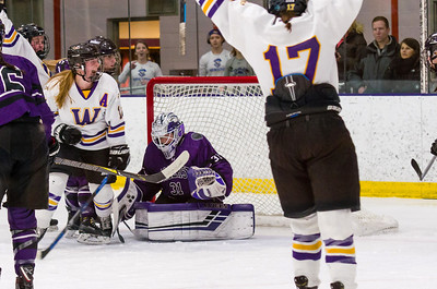 Abby Brustad (11) celebrates her second period goal against Amherst goalie Caitlin Walker.