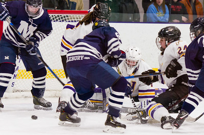 Ephs goaltender Chloe Heiting watches the puck squirt by Middlebury sticks during a few tense moments late in the third period.