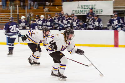 Abby Brustad (11) and Annie Rush (15) race to congratulate their goal seconds after time expired in their 3-2 win over Middlebury.