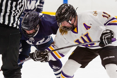 Abby Brustad (11) fights for a faceoff win late in the third period.