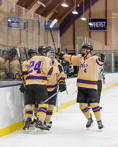Jack McCool (24) gets a hug from Connor Meike (4) after tying the game at 2 apiece late in the third period against Trinity.