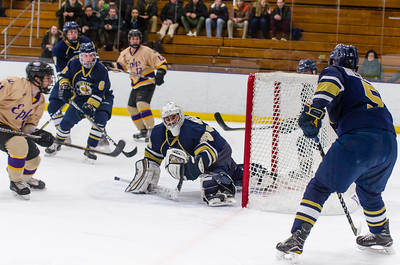 Roberto Cellini (11) puts the puck past Trinity goaltender Jonah Capriotti (39) in the first period.