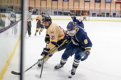 Ephs Will Somers (21) battles along the boards with Timothy Weinstein (6).