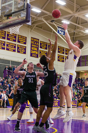 Matt Karpowicz (24) out-jumps Fru Che (25) and gets two for Williams in the first half against Amherst Friday night.