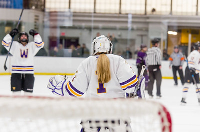 Ephs goaltender Chloe Heiting (1) celebrates as teammates close in after defeating Amherst Saturday.