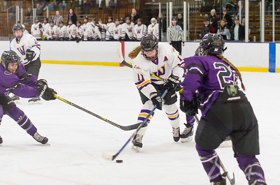Abby Brustad (11) breaks free from the Amherst defense and takes a shot on goal Saturday.