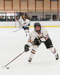 Annie Rush corrals a loose puck and launches a shot on net.