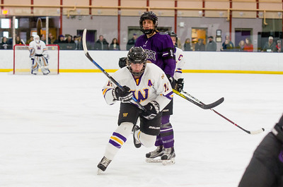 Abby Brustad (11) drives toward the net early in the first period.