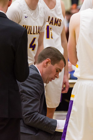 Kevin App talks strategy with his players during a timeout in the second half.
