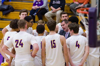 Head Coach Kevin talking with his players during a break in the first half of the Ephs game against Amherst Wednesday night.
