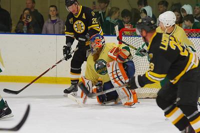 Amanda Cariddi makes a save on Bob Sweeney (20).