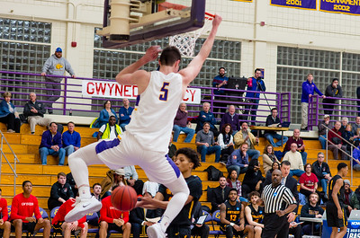 James Heskett (5) slam dunks a ball early in the first half.