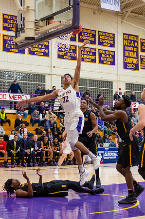 Kyle Scadlock (32) scores a couple points early in the first half Saturday night.