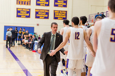Ephs head coach Kevin App congratulates his on his players on their second-round win.