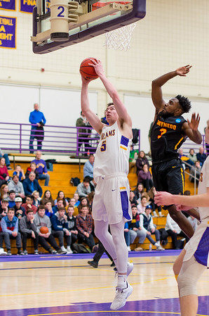 James Heskett (5) goes up hard underneath Somah Slewlon (3) and makes the bucket in the second half.
