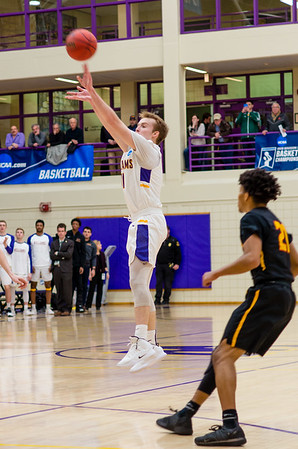Bobby Casey (11) drains a 3-pointer during the first half Saturday night. He would end up going 4 for 7 from beyond the arc.