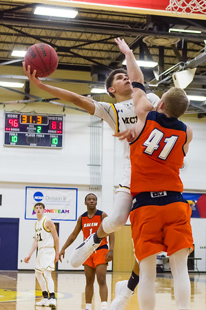 Trailblazer Quentin Gittens (13) goes for a layup around the outstretched arms of the Vikings Patrick Bugler (41).