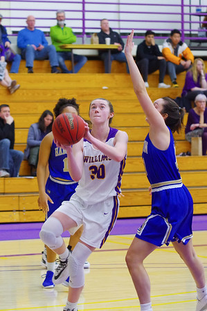 Maddy Mandyck (30) drives inside for a layup Saturday against Hamilton.