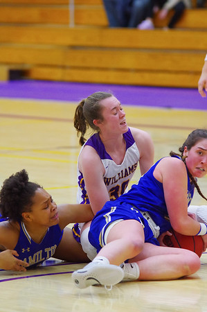 Maddy Mandyck (30) fights for possession after a broken play late in the second quarter.