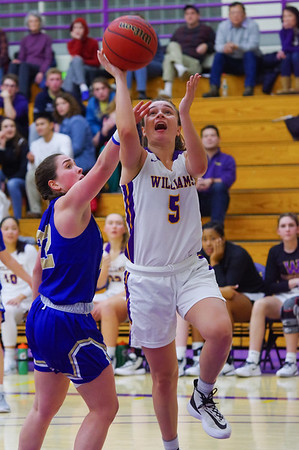Maggie Meehan (5) drives past Mackenzie Aldridge (22) for an Ephs bucket late in the fourth quarter.