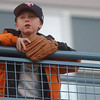 Kevin Beyersdorf, 8, of Sylvania waits with his mit in the upperdeck of Fifth Third Field for a foul ball.<br /> Photo Ben French