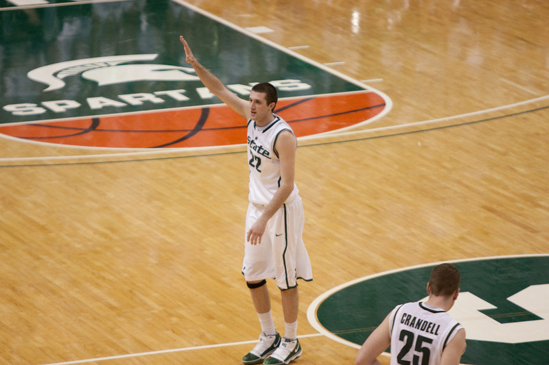 Senior Isaiah Dahlman waves to the crowd as he walks off on senior day.
