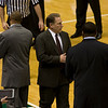 Tom Izzo has last minute pre game comments with assistant coach Dwayne Stephens.