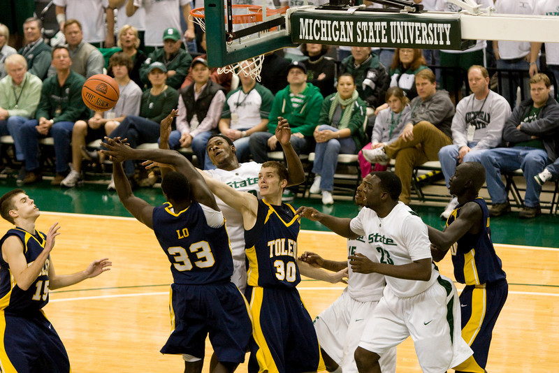 Michiagan State and Toeldo battle for the rebound.