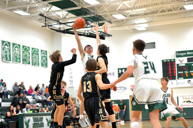 Matthew Gaston | The Sheridan Press<br>Tongue River's Eli Cummins (32) floats a shot over two Wright defenders for the bucket Friday, Jan. 18, 2020. The Eagles won 68-26.