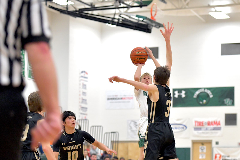 Matthew Gaston | The Sheridan Press<br>Tongue River's Wyatt Ostler (10) pulls up quick to shoot the jumper against Wright Friday, Jan. 17, 2020. The Eagles beat the Panthers 68-26.