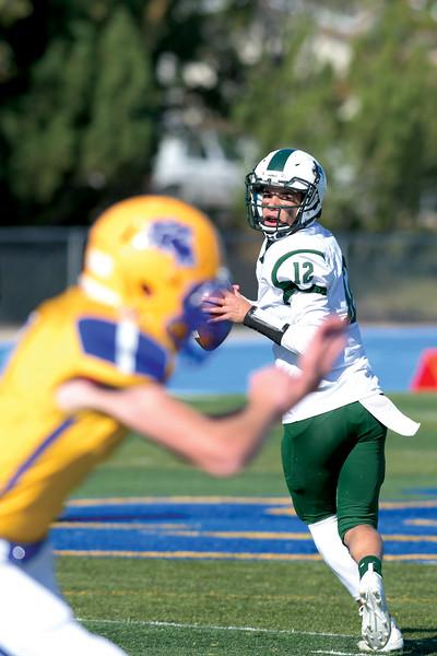 Matthew Gaston | The Sheridan Press<br>Tongue River quarterback Brayden McCafferty (12) drops back for to make the pass Saturday, Oct. 19, 2019.