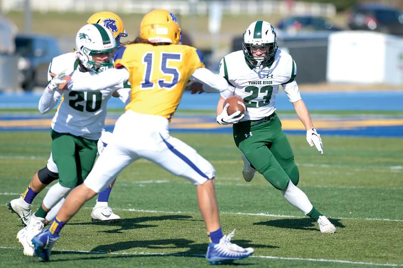 Matthew Gaston | The Sheridan Press<br>Tongue River's Kyle Breen (23) runs for a first down at Homer Scott Field against the Sheridan High School junior varsity Saturday, Oct. 19, 2019.
