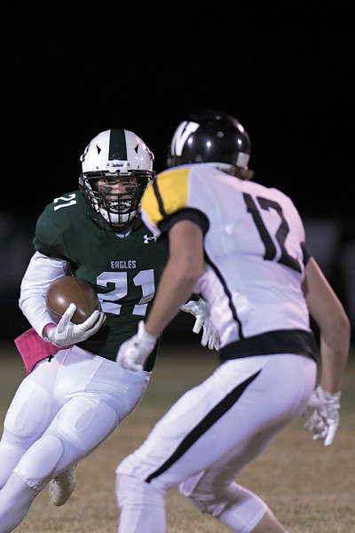 Matthew Gaston | The Sheridan Press<br>Tongue River's Gabe Federick (21) cuts up field on the run against Wright Friday, Oct. 25, 2019.