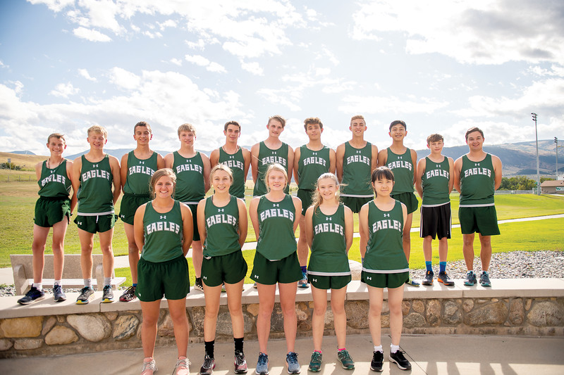 Ashleigh Snoozy | The Sheridan Press<br>Tongue River High School cross-country team, back row from left, are Michael Barron, Wyatt Ostler, Wes Beadle, Tristan Lewis, Jason Barron, Michael Perry, Cooper Vollmer, Jett Walker, Al Spotted, Cash McMeans and Ty Doke. Front row, from left, are Macey Van Tassell, Chloe Wilson, Kalie Bocek, Elizaveth Heser and Rita Xia.