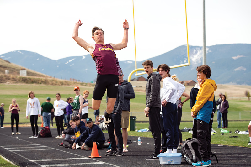 Matthew Gaston | The Sheridan Press<br>Big Horn's Liam Greenelsh launches off the board during the long jump Friday, April 26, 2019.