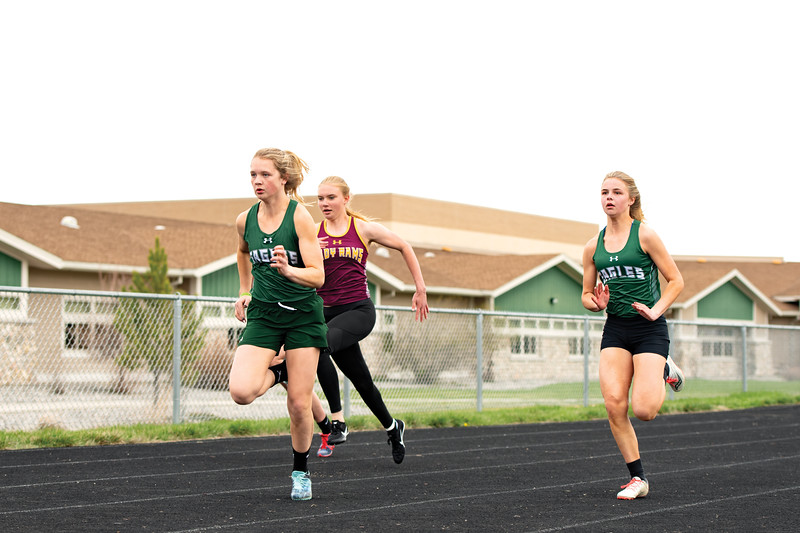 Matthew Gaston | The Sheridan Press<br>Tongue River's Carleigh Reish begins to break away during the 100-meter dash Friday, April 26, 2019. Tongue River High School hosted Big Horn and Greybull for a meet.