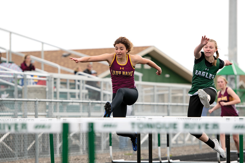 Matthew Gaston | The Sheridan Press<br>Big Horn's Jenny Trabert and Tongue River's Jane Pendergast are neck and neck during the girls 100-meter hurdles Friday, April 26, 2019.