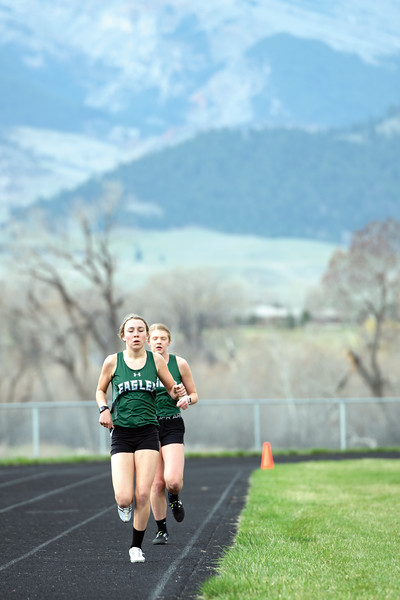 Matthew Gaston | The Sheridan Press<br>Tongue River's Chloe Wilson, left, and Kalie Bocek run the 1600-meter Friday, April 26, 2019.